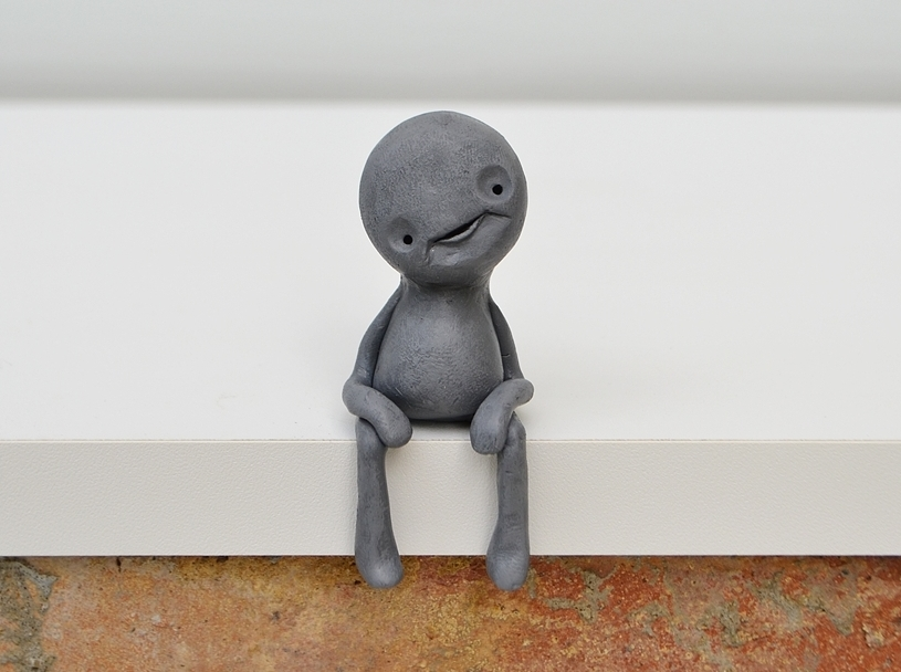 Zeno_extraterrestrial_sculpture_sitting_shelf_creature_grey_alien_gray_cute_cropped