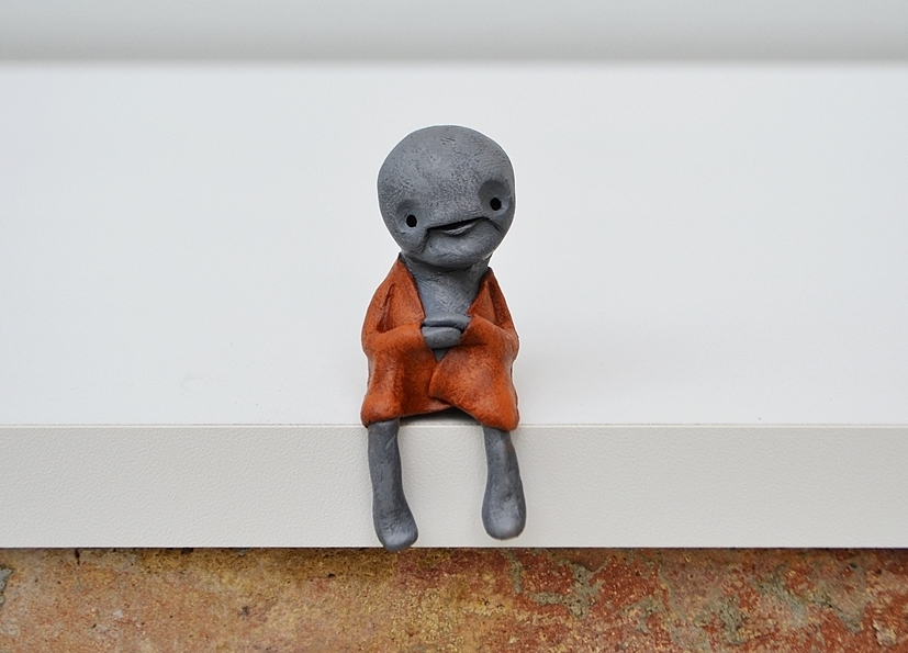 Zeno_extraterrestrial_zen_sculpture_sitting_shelf_creature_robe_alien_cute_cropped
