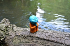 Anshin_-_monk_sculpture_praying_river_spiritual_outdoors_monks_serene_blue_buddha_nature_krishna_colours_close_up_shpn-c4