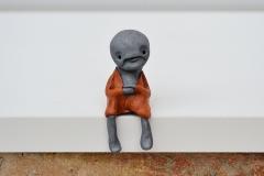 Zeno_extraterrestrial_zen_sculpture_sitting_shelf_creature_robe_alien_cute_cropped