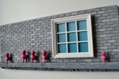 window_brick_wall_sculpture_pink_beings_angle