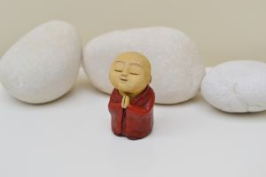 Anshin - red brown monk sculpture serene spiritual praying meditation.JPG